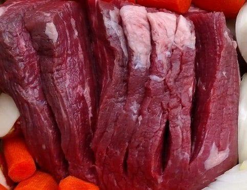 crock pot pot roast scoring the meat