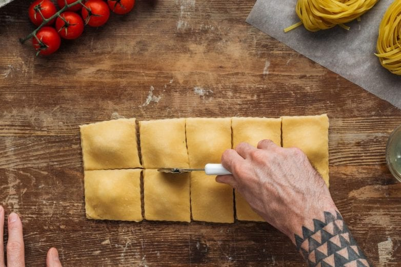 Step 4 of making your homemade ravioli is cutting it into squares. Ravioli is now ready to freeze or cook as desired.