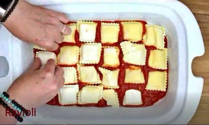 Step 2 for Slow Cooker Ravioli is Frozen Ravioli Layer #1