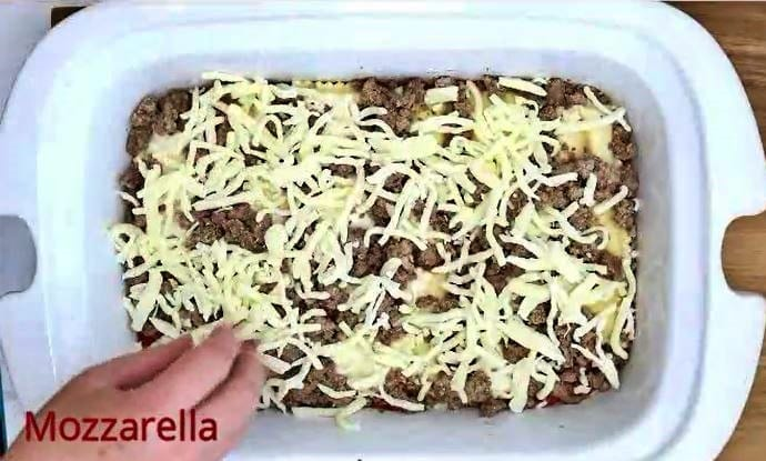 Step 4 for Ravioli Lasagna is Shredded Mozzarella Cheese Layer #1