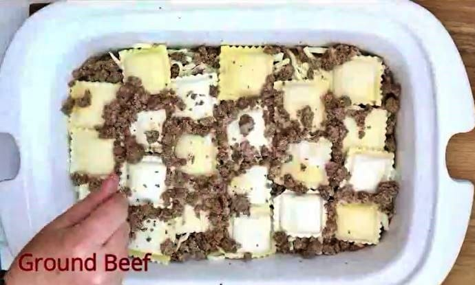 Step 6 for making lazy day lasagna in a crock pot is ground beef layer #2