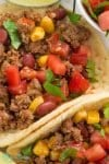 Budget friendly, quick and tasty slow cooker taco meat! With crockpot, oven-baked, pressure cooker, & freezer friendly directions!