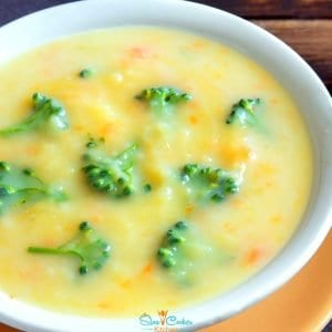 Super easy, deliciously tasty slow cooker broccoli cheese soup! With slow cooker, stove-top, pressure cooker, & freezer friendly directions!